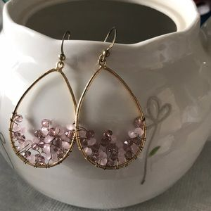 Hoop earrings with pink and purple rhinestones